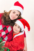 Hispanic Family and Child having fun decorating a Christmas tree — Stockfoto