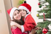 Hispanic Family and Child having fun decorating a Christmas tree — Стоковое фото