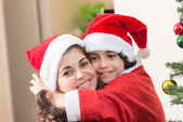 Hispanic Family and Child having fun decorating a Christmas tree — Stock Photo