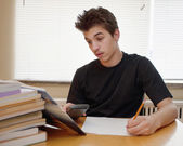 Teen doing his homework — ストック写真