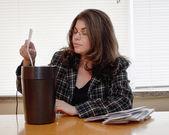 Woman shredding documents — Photo