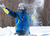Child playing in the snow — Stock Photo