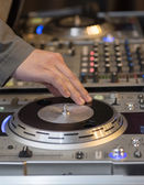 DJ working his console — Stock Photo