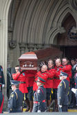 Ceremony of getting Jim Flaherty's casket back in the funeral car — Stock Photo