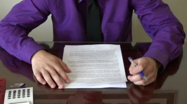 Young business man revising or reading a draft for a contract before signing — Stock Video