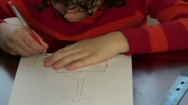 Child drawing or sketching a church in a piece of white paper — Stock Video