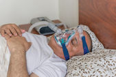 Obese man suffering from sleep apnea — Stock Photo
