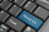 About us on keyboard — Stock Photo
