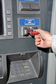 Withdraw money from ATM machine — Stock Photo