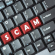 Scam on keyboard — Stock Photo