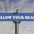 Follow your heart road sign — Stock Photo