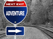 Adventure road sign — Stock Photo