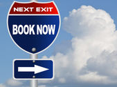 Book now road sign — Stock Photo