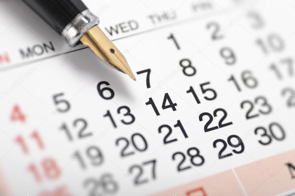 Pen pointing the date 14 on calendar — Stock Photo #18625747