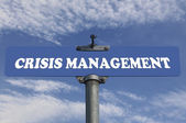 Crisis management road sign — Stockfoto