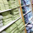 Towels on shelves in the shop — Stock Photo