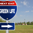 Green life road sign - Stock Photo