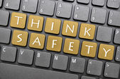 Think safety on keyboard — Stock Photo