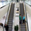 In motion in escalator — Stock Photo