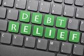 Alivio de la deuda en el teclado — Foto de Stock