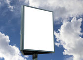Large blank, empty, white billboard screen, on cloudy sky — Stock Photo