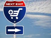 Shopping cart symbol road sign — Stock Photo