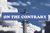 On the contrary road sign — Stock Photo