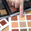 Hand pointing to sample color chart — Stock Photo