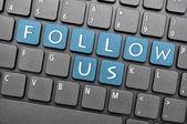 Follow us on keyboard — Stock Photo