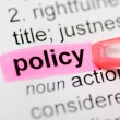 Pink marker on policy word — Stock Photo