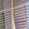 Stock Photo: Piles of multicolored towels on sale