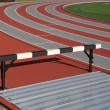 Track and athlete hurdling field  — Foto de Stock