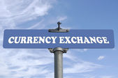 Currency exchange road sign — Stock Photo