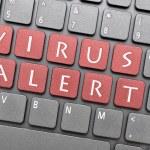 Virus alert key on keyboard — Stock Photo