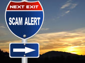 Scam alert road sign — Stock Photo