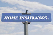 Home insurance road sign — Stock Photo