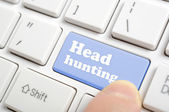 Pressing head hunting on keyboard — Stock Photo