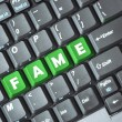 Fame on keyboard — Stock Photo