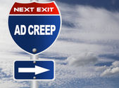 Ad creep road sign — Stockfoto