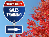 Sales training road sign — Stock Photo