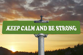 Keep calm and be strong road sign — Stock Photo