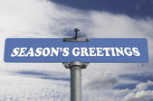 Season's greetings road sign — Stock Photo
