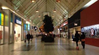 Shopper inside Coquitlam Center shopping mall — Stock Video