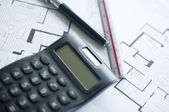 Architect with calculator and plan, pencil and ruler — Stock Photo