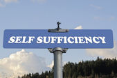 Self sufficiency road sign — Stock Photo