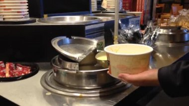 Soup being poured into paper cup — Vídeo Stock