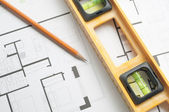 Level and pen on an architects plan  — Stock Photo