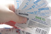 Holding saving coupons — Stock Photo
