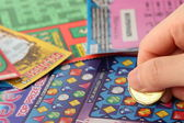 Scratching lottery tickets — Stock Photo