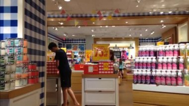 Woman choosing liquid scent on display shelf — 图库视频影像